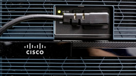 A Cisco logo is seen on a router.