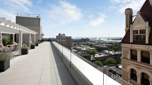 Roof decks are an important amenity at new apartment buildings in New York City.