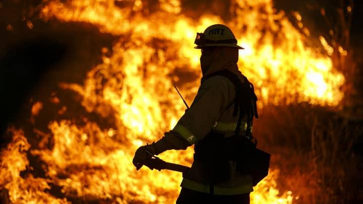 Firefighters monitor the Blue Cut fire burning alongside Lytle Creek Road, in San Bernardino County, Calif., on Aug. 17, 2016.