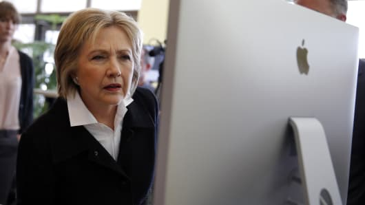 Democratic presidential candidate Hillary Clinton looks at a computer screen during a campaign stop at Atomic Object company in Grand Rapids, Michigan, March 7, 2016.