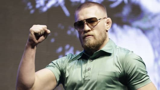 Conor McGregor arrives at a UFC 202 mixed martial arts news conference, Thursday, July 7, 2016, in Las Vegas. McGregor is scheduled to fight Nate Diaz at UFC 202 in Las Vegas.