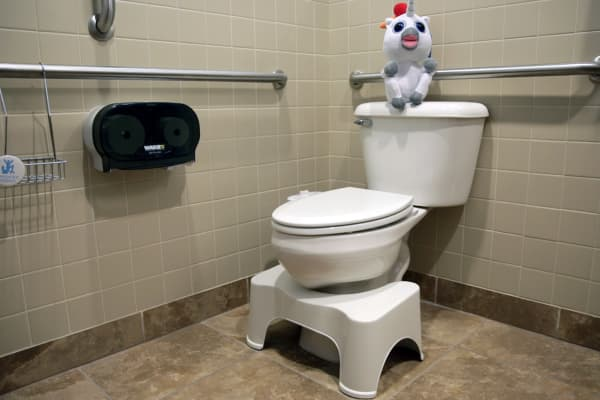 The Squatty Potty tucks right in to most toilets.