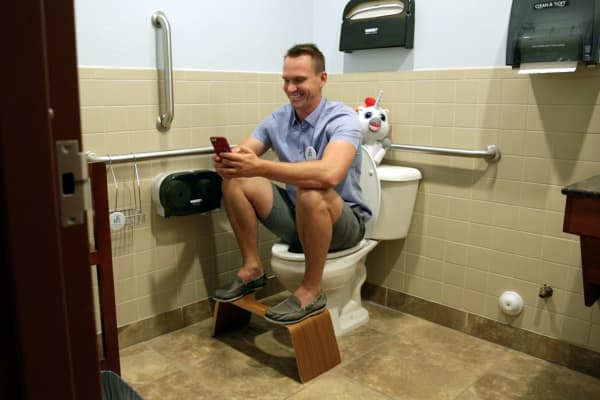 Bobby Edwards demonstrates how the Squatty Potty works.