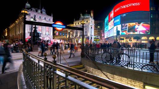 Long exposure of pedestrians and traffic outside Piccadilly Circus tube station in London, taken on October 21, 2014.
