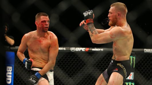 Nate Diaz punches Conor McGregor during UFC 196 at the MGM Grand Garden Arena on March 5, 2016 in Las Vegas, Nevada.