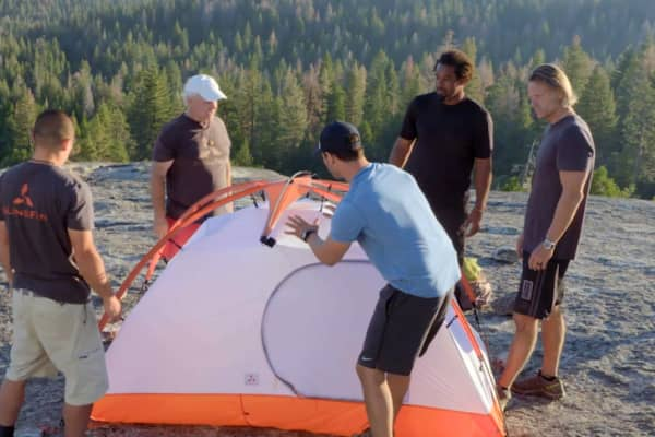 "SlingFin shows off its tent to potential investors and hosts of CNBC's ""Adventure Capitalists."""