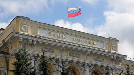 A national flag flies above the headquarters of the Central Bank of the Russian Federation in Moscow.