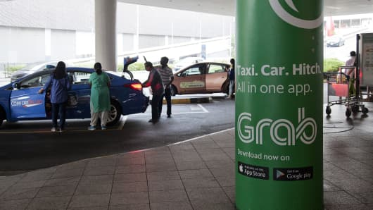 An advertisement for the ride-hailing application Grab displayed at a taxi stand in Singapore
