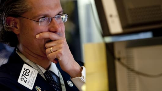 Donald Civitanova works at a post on the floor of the New York Stock Exchange in New York, U.S., on Thursday, May 6, 2010. The Dow Jones Industrial Average had its biggest intraday loss since the market crash of 1987.