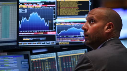 A trader works on the floor of the New York Stock Exchange (NYSE) on August 24, 2015 in New York City.