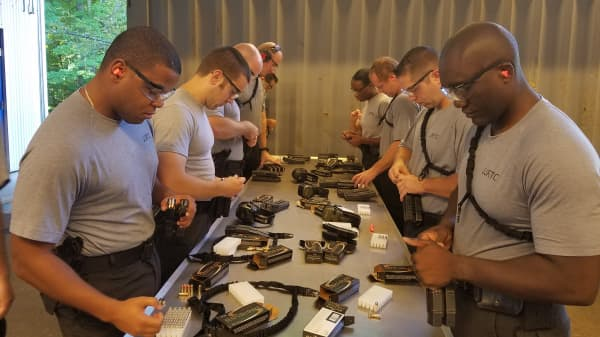 Special agent trainees in firearms training class