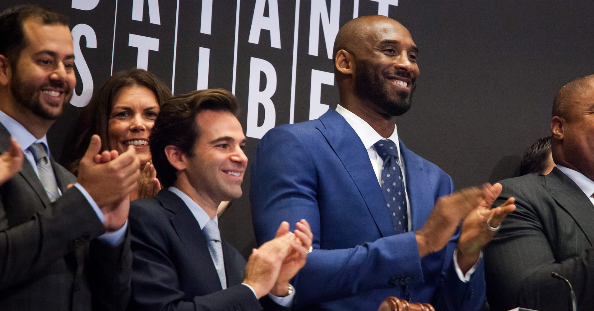Investor Jeff Stibel, center, and Kobe Bryant, former National Basketball Association player, right, applaud while ringing the opening bell after unveiling their venture capital fund Bryant Stibel at the New York Stock Exchange.
