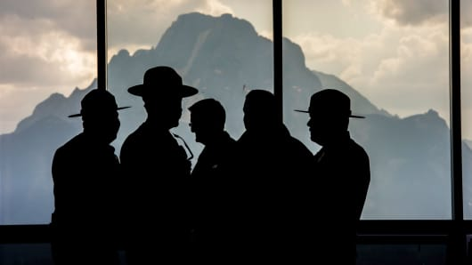 National Park Rangers stand silhouetted inside the lobby of Jackson Lake Lodge during the Jackson Hole economic symposium, sponsored by the Federal Reserve Bank of Kansas City, in Moran, Wyoming, last August.