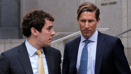 Former Perella Weinberg investment banker Sean Stewart (R) exits the Manhattan federal court house in New York City, U.S., July 27, 2016.