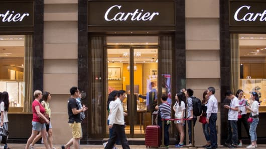 Shoppers line up to enter a Cartier store, a unit of Cie. Financiere Richemont SA, on Canton Road in the Tsim Sha Tsui area of Hong Kong.