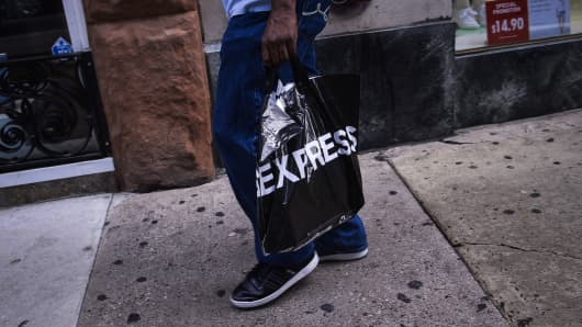 A shopper carries an Express Inc. bag while walking in the Center City neighborhood of Philadelphia Pennsylvania, U.S., on Friday, June 24, 2016.
