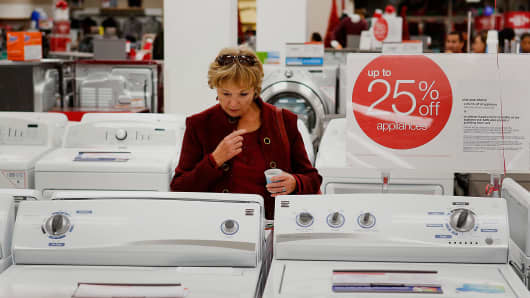 A customer browses washing machines at a Sears store during the Family and Friends evening sale inside the Del Amo shopping mall in Torrance, California.