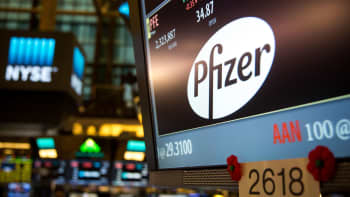 Pfizer signage is displayed on a monitor on the floor of the New York Stock Exchange.