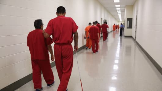 Detainees at the Adelanto Detention Facility, managed by a private company.