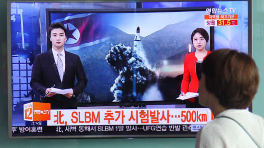 People in South Korea watch a TV news program about the DPRK ballistic missile launch on August 24, 2016.