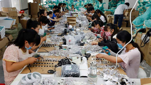 Workers at a toy factory in Jiangsu province.