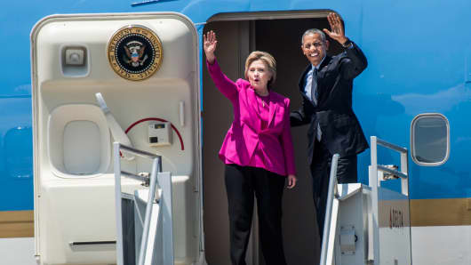 Hillary Clinton and President Obama arrive aboard Air Force One in Charlotte, North Carolina, on July 5, 2016.
