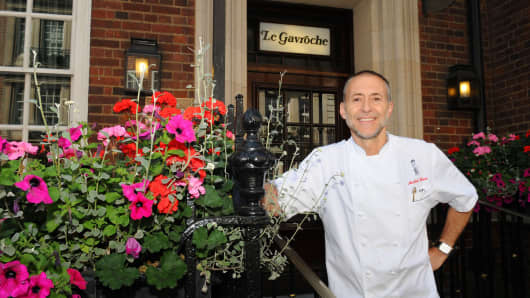 British-French Chef, Michel Roux Jr., poses at his restaurant, Le Gavroche, in London.