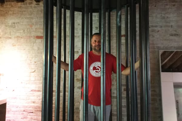 Turney Duff tests out the go-go cage in the apartment James Altucher is renting via Airbnb.