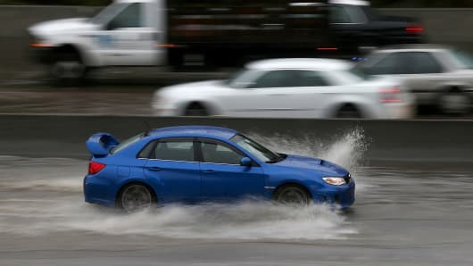 Car in heavy rain, puddle, storm