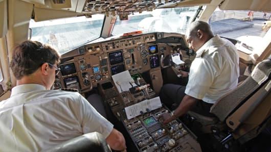 Pilots parking plane in Miami International Airport