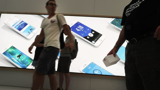 Customers shop at an Apple store in New York City.