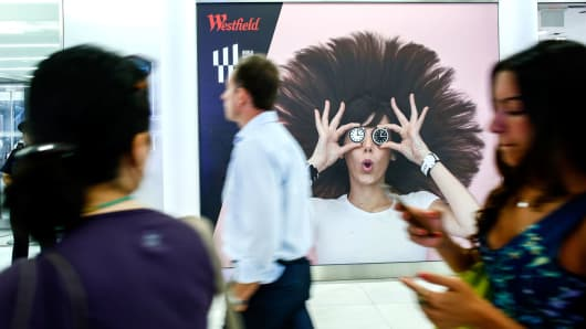 People walk by the Westfield World Trade Center shopping mall in New York.