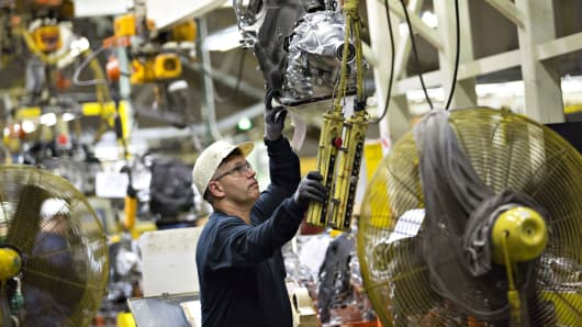 An employee moves a transmission at the Subaru of Indiana Automotive manufacturing facility in Lafayette, Indiana.