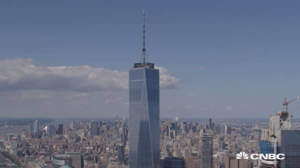 Watch these men climb One World Trade Center's spire
