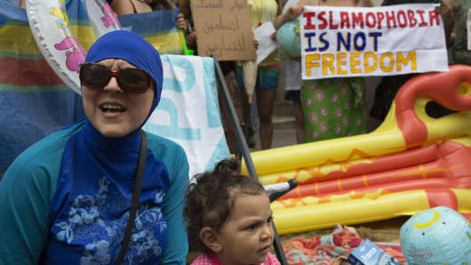 A 'wear what you want' protest against the burkini ban for Muslim women on French beaches on 25th August 2016, outside the French embassy in London, United Kingdom.