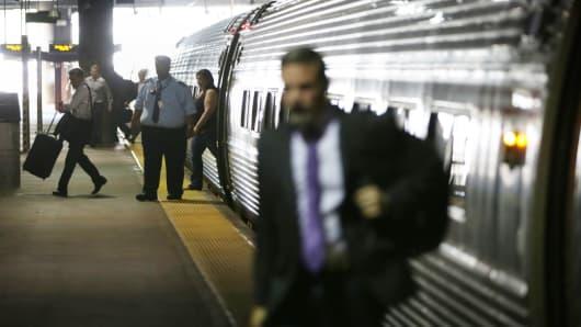 Passengers getting off an Amtrak train.