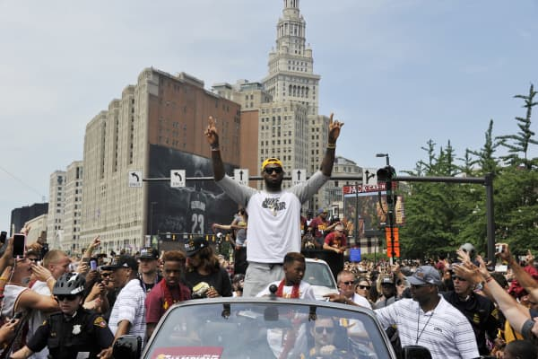 LeBron James #23 of the Cleveland Cavaliers waves to the fans during the Cleveland Cavaliers Victory Parade And Rally on June 22, 2016 in downtown Cleveland, Ohio.
