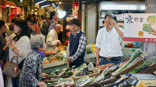 Shopping in Nishiki Market in Kyoto, Japan.