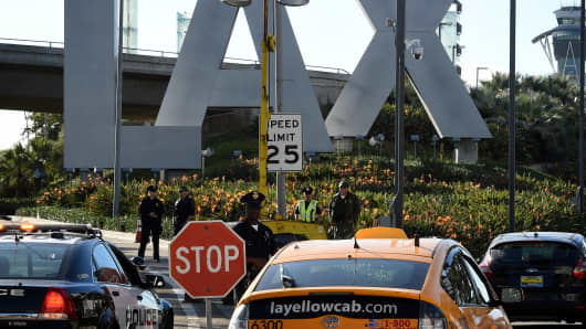 Police keep watch at Los Angeles International Airport (LAX) on November 25, 2016.