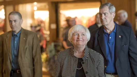 Janet Yellen (C) , chair of the U.S. Federal Reserve, arrives at the Jackson Hole economic symposium.