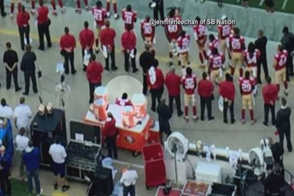 Colin Kaepernick refuses to stand for US national anthem