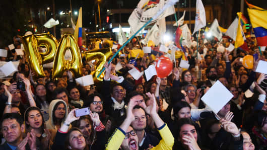 Colombians in Bogota celebrate the conclusion of peace talks on August 24, 2016.