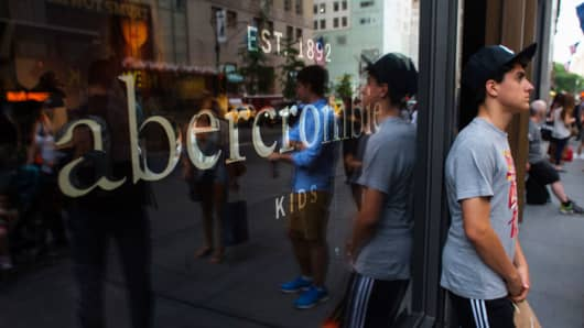 A pedestrian stands outside of the Abercrombie & Fitch store on Fifth Avenue in New York City.