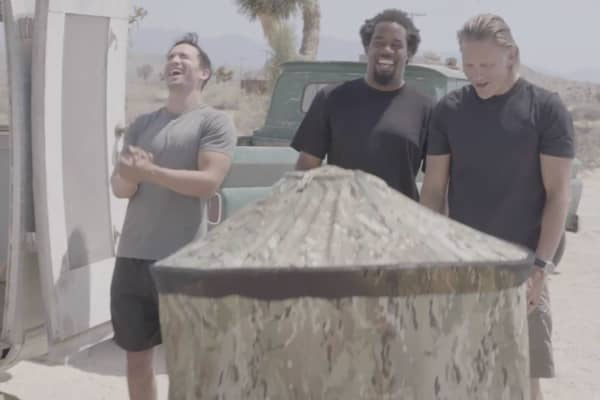 "CNBC's ""Adventure Capitalists""  Craig Cooper, Jeremy Bloom, and Dhani Jones watch as InstaPrivy creator Paul Mangum goes inside his product's privacy shelter — a tent-like non-metal structure made of nylon ripstop material."
