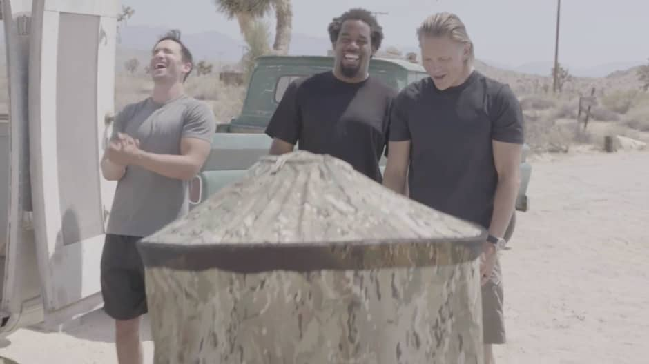 """CNBC's """"Adventure Capitalists""""  Craig Cooper, Jeremy Bloom, and Dhani Jones watch as InstaPrivy creator Paul Mangum goes inside his product's privacy shelter — a tent-like non-metal structure made of nylon ripstop material."""