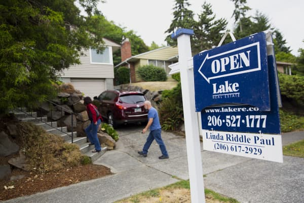 Potential home buyers attend an open house in the Seattle, Washington.