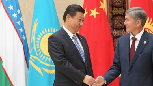 Chinese President Xi Jinping is greeted by Kyrgyz President Almazbek Atambayev during a summit in Bishkek, Kyrgyzstan.