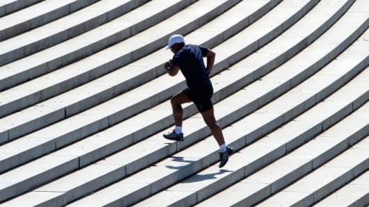 Man running up steps