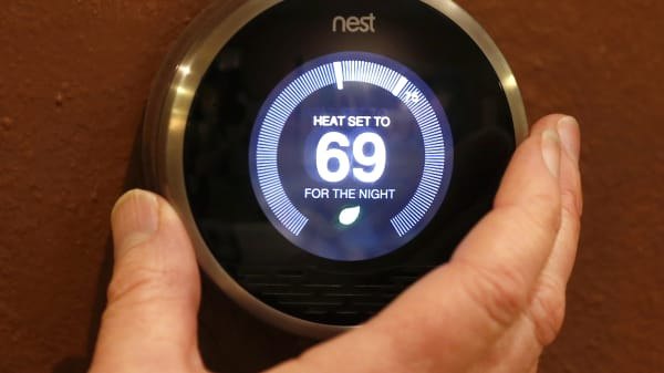 Nest thermostat is being adjusted in a home in Provo, Utah.