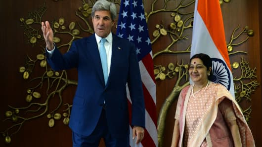 Indian Minister of External Affairs Sushma Swaraj and US Secretary of State John Kerry speak prior to a meeting in New Delhi on August 30, 2016